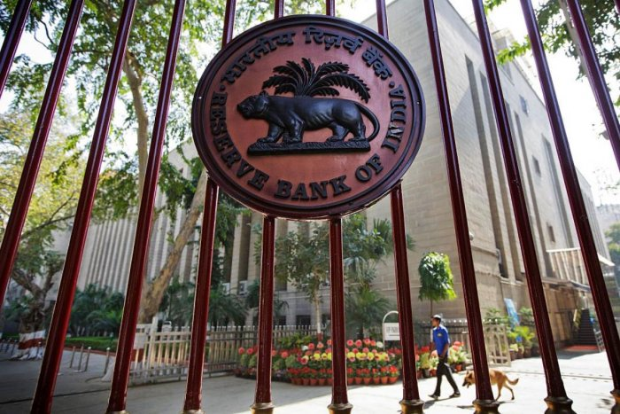 The Reserve Bank of India (RBI) logo is displayed on a gate at the central bank's headquarters in New Delhi, India. Credit: Bloomberg Photo