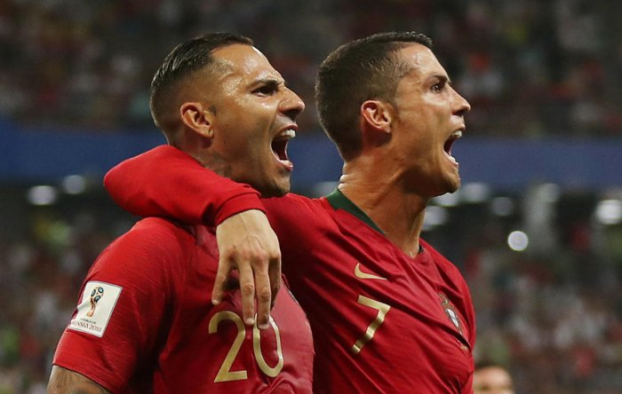 Ricardo Quaresma celebrates scoring their first goal with Cristiano Ronaldo. Reuters
