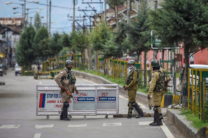 Security personnel stand guard at a check-point, during curfew like restrictions on the 13th consecutive day, following the abrogation of the provisions Article 370 in Jammu and Kashmir, in Srinagar, Saturday, Aug. 17, 2019. (PTI Photo)