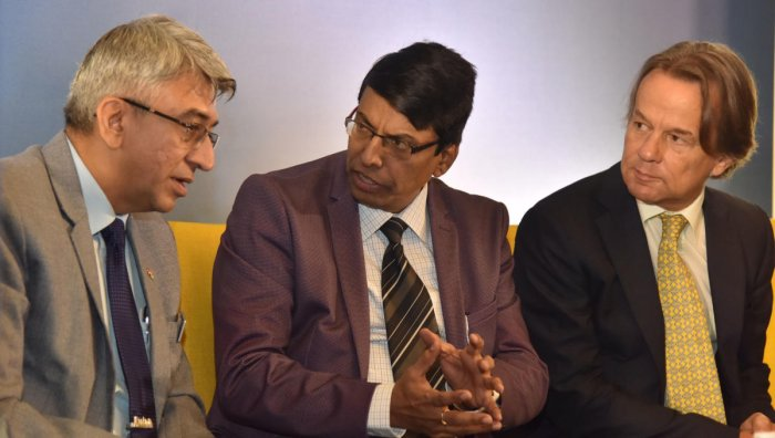 (From left) Rajesh Nath, Managing Director of VDMA, Shivayogi C Kalasad, Managing Director of Karnataka State Road Transport Corporation and Peter Schmid, Head of Administration, Consulate General of the Federal Republic of Germany, Bengaluru at the inauguration of Electric Mobility – Disrupting Technology in the Transportation Industry in Bengaluru on Thursday, November 21, 2019. (DH Photo/Janardhan B K)