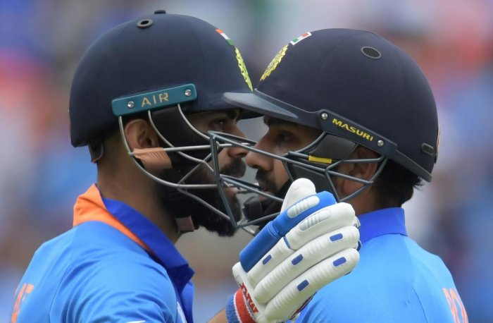 India's captain Virat Kohli (L) embraces Rohit Sharma during the 2019 Cricket World Cup group stage match between Bangladesh and India at Edgbaston in Birmingham, central England, on July 2, 2019. (Photo by AFP)