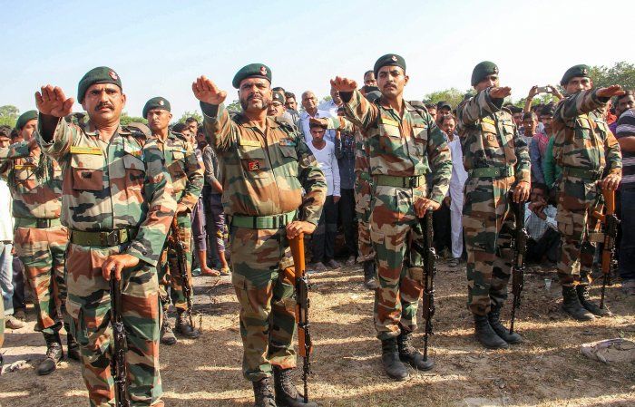 Army personnel pay tribute to rifleman Rajat Kumar Basan, who was killed along the LoC in the firing from Pakistan side, at Pallanwala village in Akhnoor Sector about 65km from Jammu, on Monday. PTI