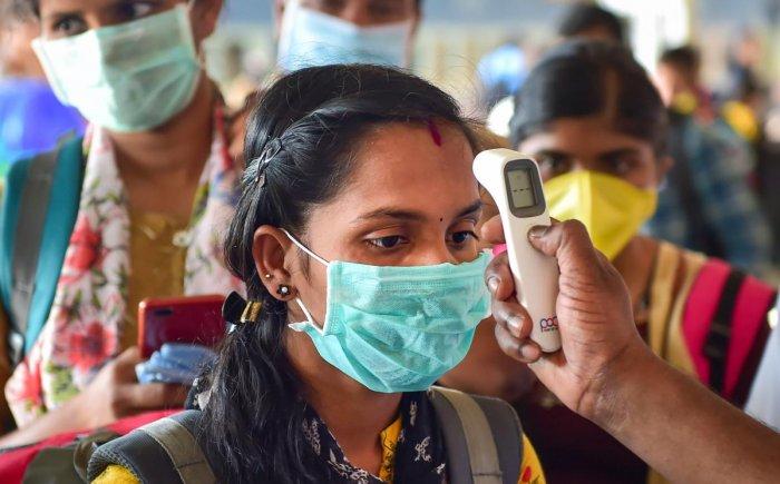 A passenger takes a thermal screening test at Bengaluru City Railway Station in the wake of coronavirus (COVID-19) pandemic, in Bengaluru, Monday, March 16, 2020. (PTI Photo)