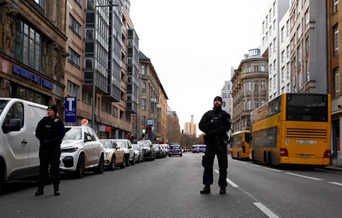 Police officers guard an area after an individual fired shots in the city centre of Berlin. Reuters