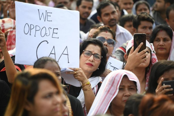 """Demonstrators take part in a musical concert to protest against Citizen Amendment Act (CAB) in Guhawati on December 15, 2019. - Some 5,000 people took part in a fresh demonstration in Guwahati on December 15, with hundreds of police watching on as they sang, chanted and carried banners with the words """"long live Assam"""". Photo/AFP"""