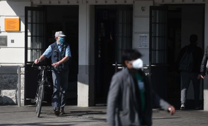 People wear protective face masks at the main railway station in Hamm on April 27, 2020, amid the new coronavirus COVID-19 pandemic. Credit: AFP Photo