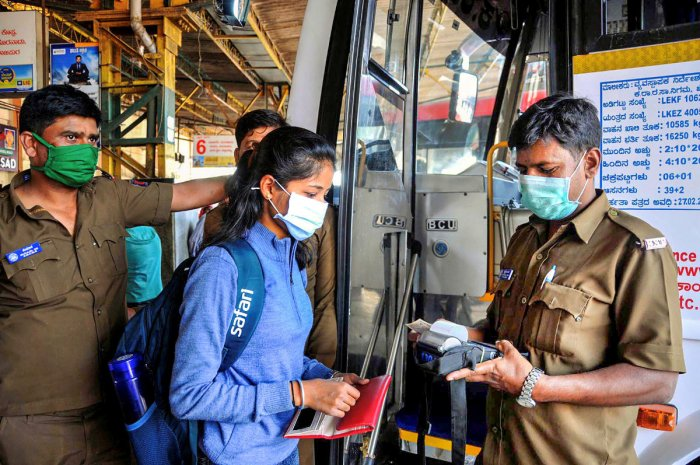 KSRTC bus conductor and passengers wear protective masks in view of coronavirus pandemic in Chikmagalur, Sunday, March 15, 2020. (PTI Photo)