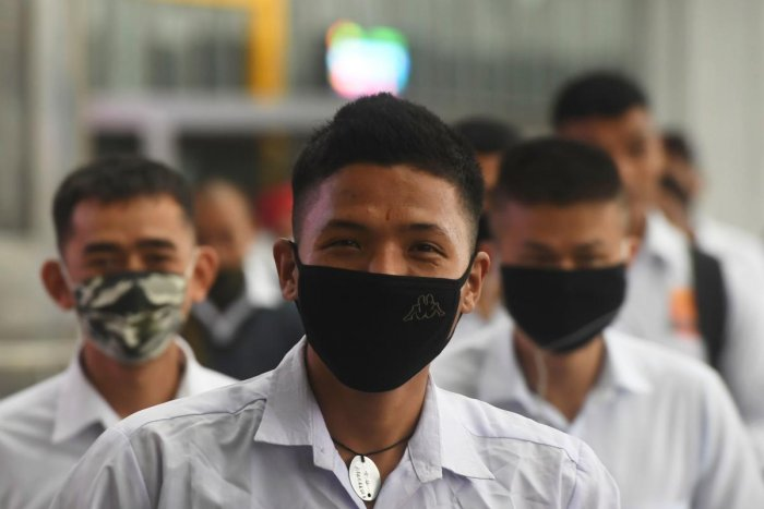 Indian security personnel wearing facemasks as a preventive measure against the spread of the COVID-19 coronavirus outbreak, enter the Netaji Subhas Chandra Bose International Airport in Kolkata on March 7, 2020. Credit: AFP Photo