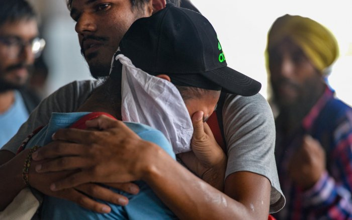 An Indian national who did not have a condition of regular stay in Mexico breaks down at Indira Gandhi International Airport after being deported, in New Delhi, Friday, Oct. 18, 2019. Mexico's migration authorities deported 311 Indians, including a woman, from various parts of the country amidst its stepped up efforts to check people illegally crossing its borders following pressure from the US. (PTI Photo/Vijay Verma)