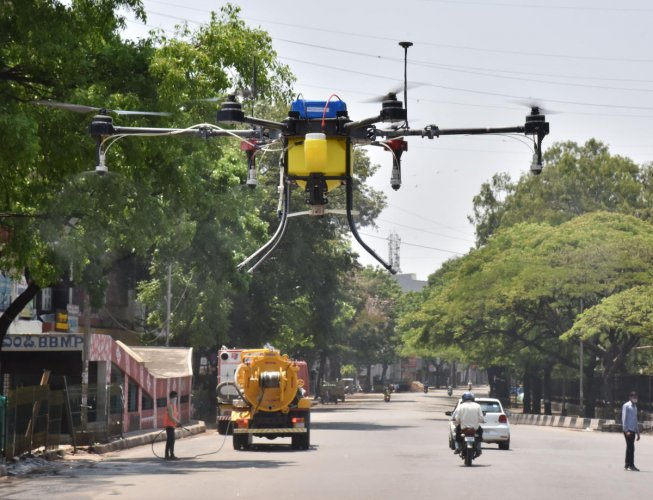 BBMP sprays disinfectant using a drone on the road near Town Hall following the COVID-19 outbreak in Bengaluru on Tuesday, March 24, 2020. Photo by (Janardhan B K/DH Photo)