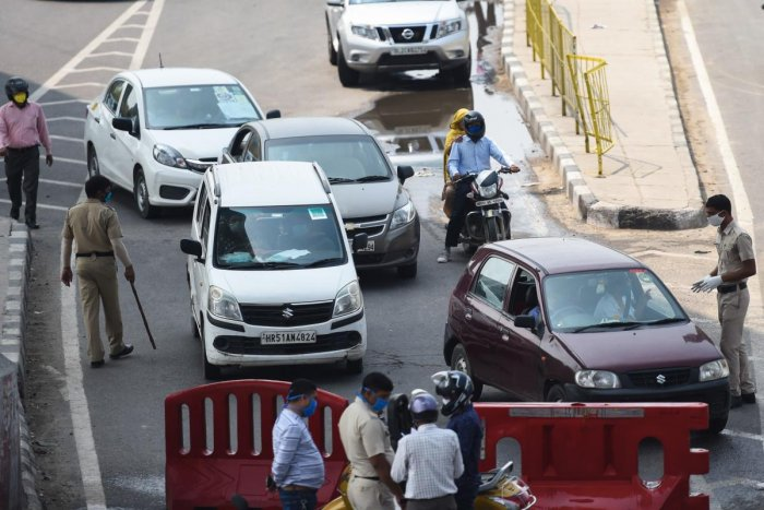 Vehicles are stopped at the state border to cross to Delhi after Haryana government sealed its border with the national capital Delhi during a government-imposed nationwide lockdown as a preventive measure against the COVID-19 coronavirus, in Faridabad on April 28, 2020. Credit: AFP Photo