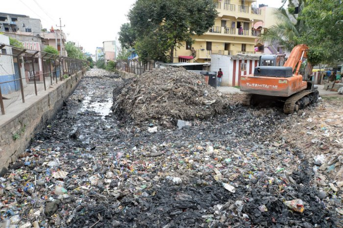A view of Rajakaluve which is filled up plastic and other waste meterial next to KPWD Quarters, Koramangala.