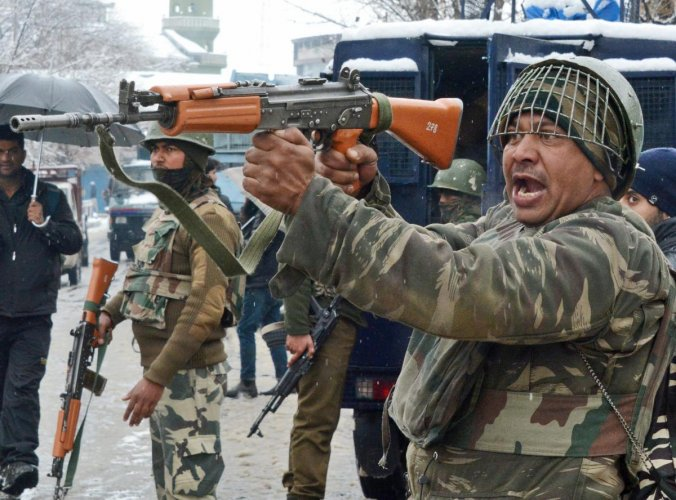 Security personnel take positions during an encounter with the militants, who were sheltering in a building near a CRPF camp at Karra Nagar, in Srinagar. PTI file photo