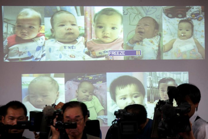 Surrogate babies that Thai police suspect were fathered by a Japanese businessman who fled Thailand are shown on a screen during a news conference at the headquarters of the Royal Thai Police in Bangkok. (Reuters file pic)