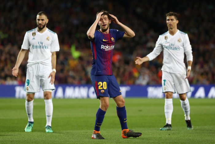 Barcelona's Sergi Roberto reacts after shown a red card. REUTERS