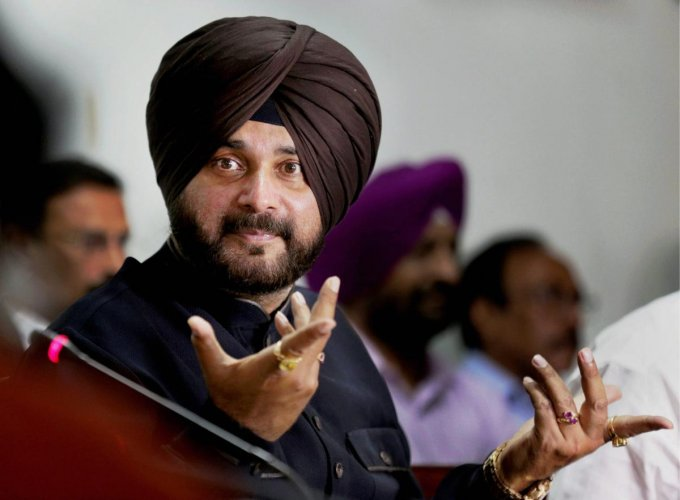 In this file photo dated Wednesday, May 02, 2018, Punjab Minister for Tourism & Cultural Affairs Navjot Singh Sidhu is seen at a press conference in Amritsar. The Supreme Court on Tuesday convicted Sidhu for voluntarily causing hurt to a 65-year-old m