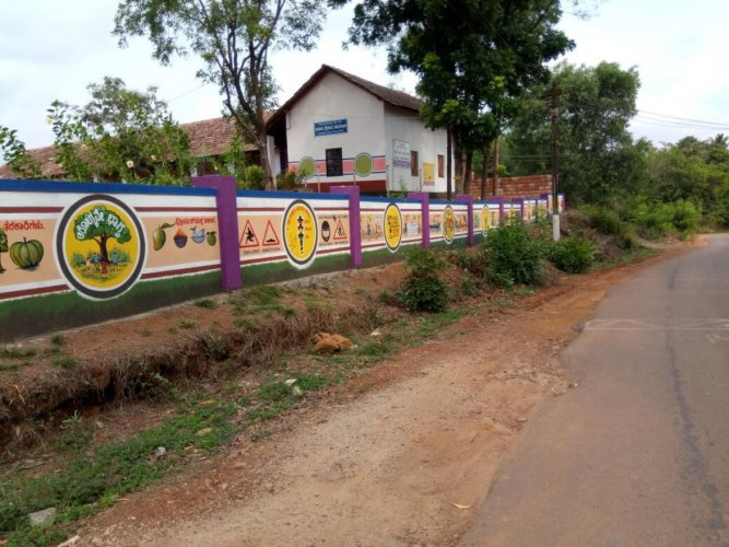 A view of the painting on the compound wall of Government High School at Nadugodu.