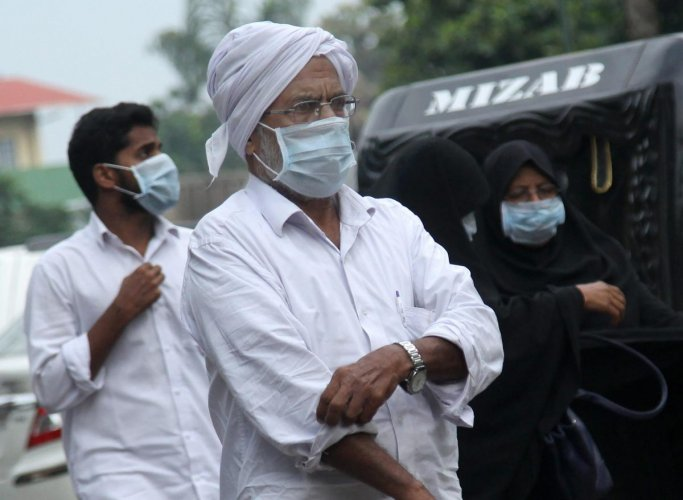 People wear safety masks as a precautionary measure after the 'Nipah' virus outbreak, at Kozhikode Medical College, in Kerala, on Saturday. PTI