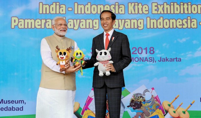 Indian Prime Minister Narendra Modi flies kites with Indonesian President Joko Widodo at the inauguration of the India-Indonesia Kite Exhibition, in Jakarta, Indonesia, Wednesday. PTI Photo