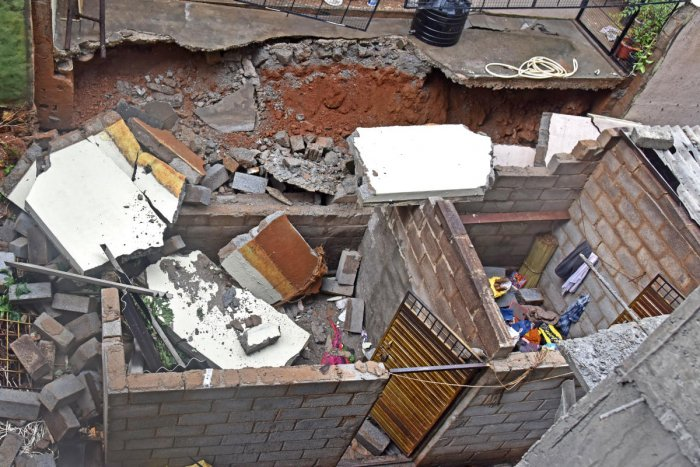 The wall next to a construction site that collapsed on a shedkilling a labourer in Bengaluru on Saturday. DH PHOTO/S K DINESH