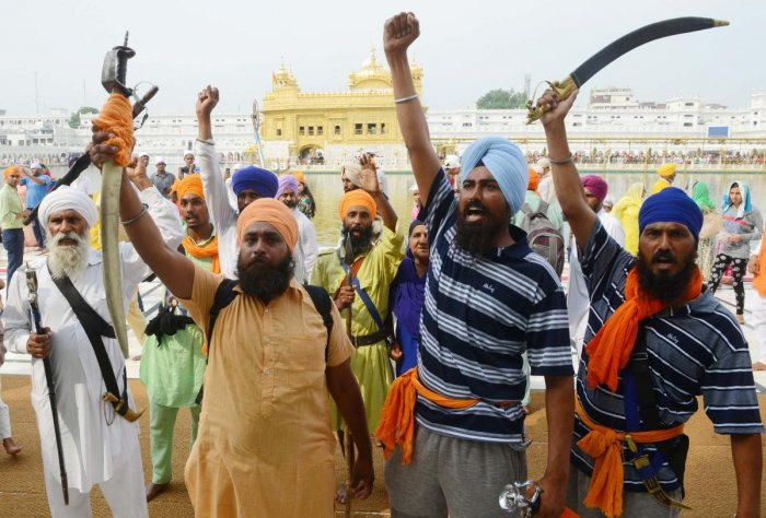 Indian Sikh radical activists shout pro-Khalistan slogans on the occasion of 34th anniversary of Operation Blue Star at the Golden temple in Amritsar. (AFP File Photo)