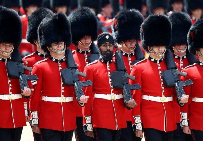 Charanpreet Singh Lall, aged 22, a Sikh from Leicester is the first guardsman to wear a turban. Reuters