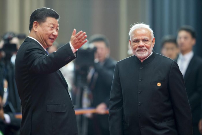 Chinese President Xi Jinping, left, welcomes Indian Prime Minister Narendra Modi for a meeting at last year's Shanghai Cooperation Organization (SCO) Summit held in Qingdao in eastern China's Shandong Province Sunday on June 10, 2018. AP/PTI Photo