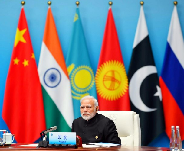 Prime Minister, Narendra Modi at the Plenary Session of the Shanghai Cooperation Organisation (SCO) Summit, in Qingdao, China. PTI Photo