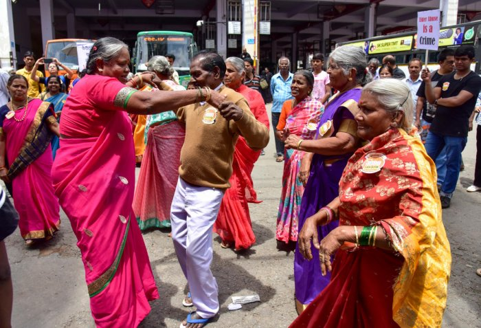 Senior citizens and members of the Nightingales Medical Trust break out into a dance during a roadshow at the Shivajinagar bus stand to mark World Elder Abuse Awareness Day on Friday. DH Photo/B H Shivakumar
