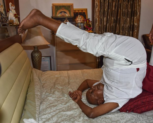 Former prime minister H D Deve Gowda performs yoga at his residence in Padmanabhanagar on the occasion of International Yoga Day on Thursday. DH Photo