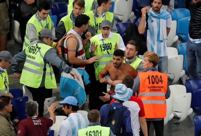 Stewards apprehend a fan after the match between Argentina and Croatia on Thursday. REUTERS