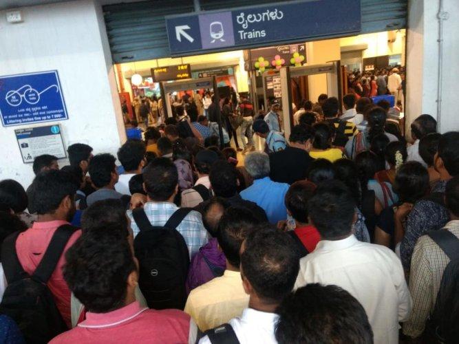 Passengers queue up to enter the Baiyappanahalli metro station around 6 pm on Friday.