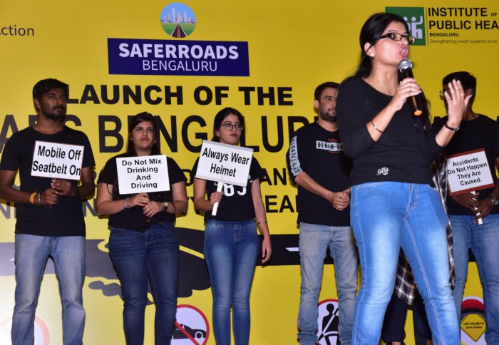 Employees of AXA create awareness during the launch of the 'Safer Roads Bengaluru' initiative at the Rajiv Gandhi University of Health Sciences (RGUHS) on Friday.