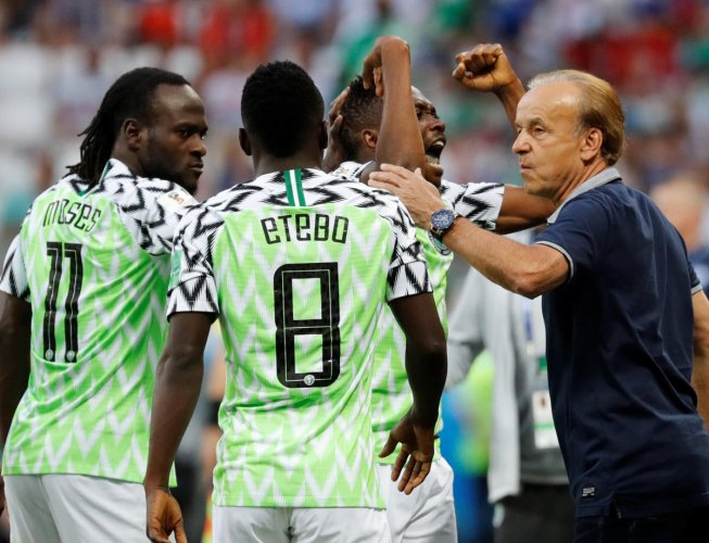 Nigeria's Ahmed Musa celebrates after scoring their first goal with team mates and coach Gernot Rohr. (Reuters)