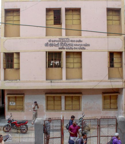 A view of Bharti School where Dev Bhagwandas Tadvi (14), a class IX student, was found with multiple stab wounds in the washroom, in Vadodara on Friday. PTI