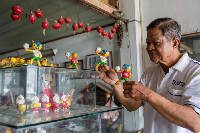 Retired Vietnamese English teacher Nguyen Thanh Tam displays various Football World Cup mascots including Fuleco (centre), the 2014 Brazil World Cup mascot, at his home in Ho Chi Minh City. AFP