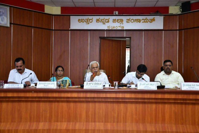 Revenue and Skill Development Minister R V Deshpande chairs a meeting to review damages caused by the rainfall in Karwar district on Saturday. DH Photo