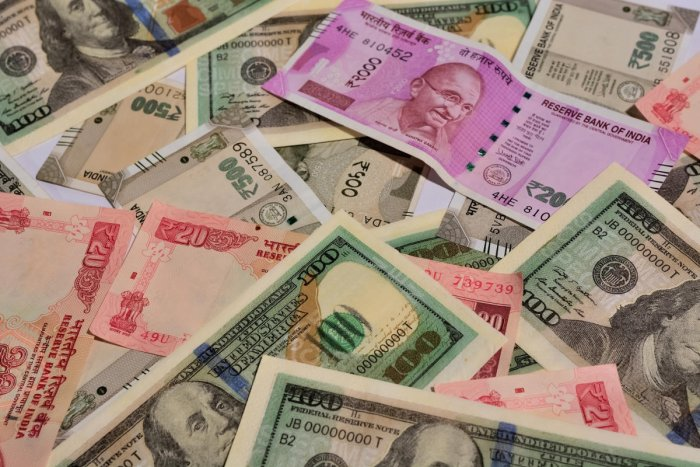 US dollar and Indian money in sixes and sevenrupee