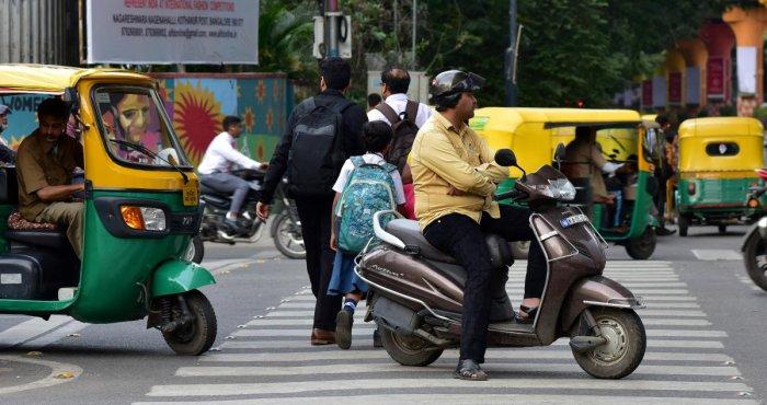 Traffic violation in Brigade road and MG road junction. (DH Photo/Ranju P)