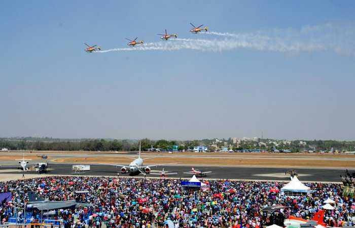 People watch an air display during the fifth and final day of the 11th biennial edition of Aero India 2017 at the Yelahanka Air base, in Bengaluru. (DH File Photo/Ranju P)