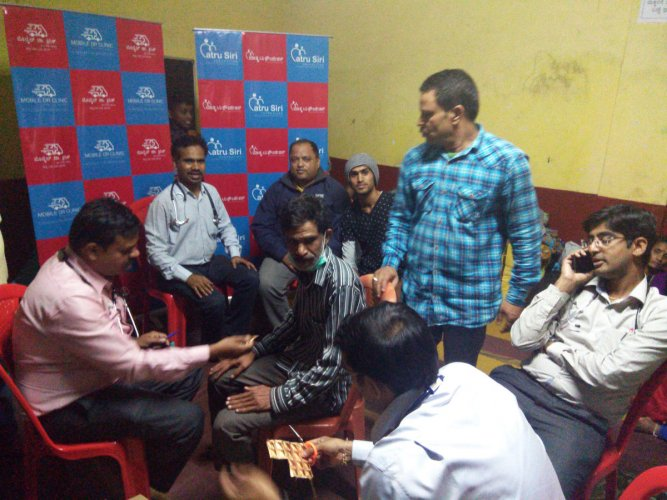 The team of doctors from Bengaluru attend to a patient at a relief camp in Kodagu.