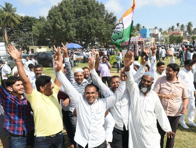 Various party supporters gathering during the MCC election counting at New Maharani's in Mysuru on Monday