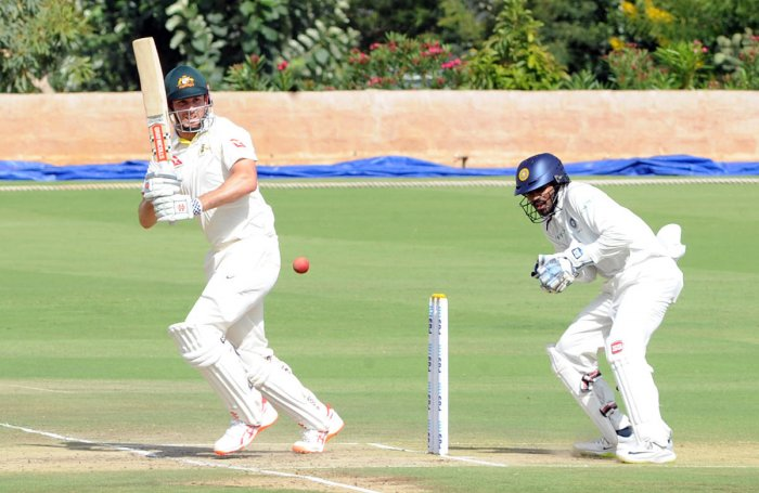 Mitchell Marsh of Australia 'A' plays a shot during his unbeaten 86 against India 'A' at the Alur ground in Bengaluru on Saturday. DH Photo