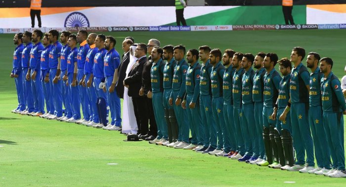 Indian and Pakistan (right) players line up for the national anthem just before the start of their Asia Cup match in Dubai. AFP