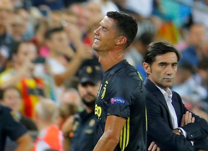 Juventus' Cristiano Ronaldo reacts after he is sent off while Valencia coach Marcelino Garcia looks on in the Champions League game on Wednesday. Reuters