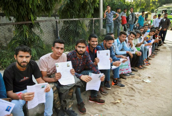 Special Police Officers (SPO) applicants wait at Police line to submit their forms, in Jammu. PTI