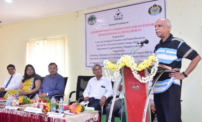 Prof K G Saxena, School of Environmental Sciences, JNU, New Delhi, speaks at a national workshop on 'Agro Biodiversity Conservation for Sustainable Socio-ecological Development' on Mangalore University campus, Mangalagangothri, on Monday.