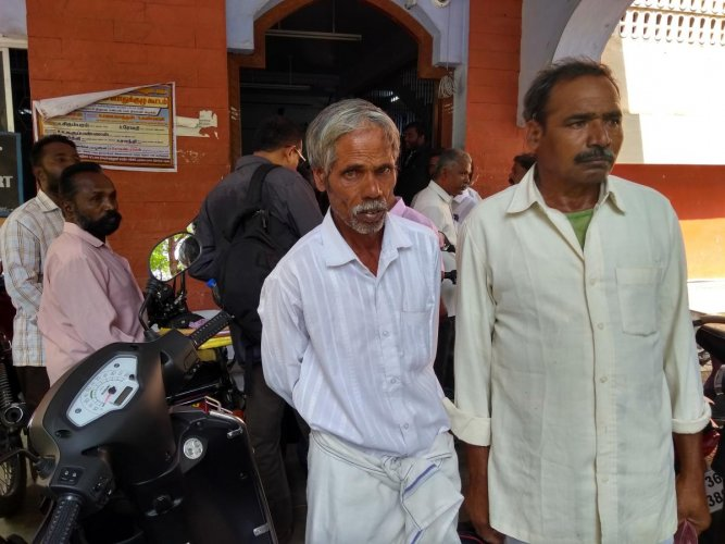 Pasuvanna and Nagarajan, who were acquitted, outside the court in Gobichettipalayam, Erode district, on Tuesday. DH Photo/E T B Sivapriyan