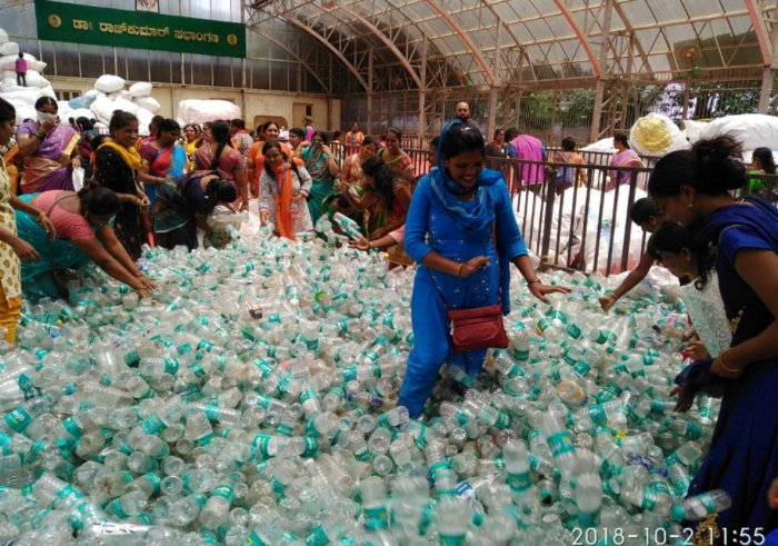 BBMP workers counting plastic bottles collected during the Plog Run, at BBMP head office on Tuesday. DH photo
