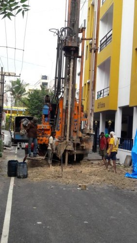 Wasted efforts: BBMP workers digging a borewell in the middle of the road at Vinayak Nagar on Thursday.